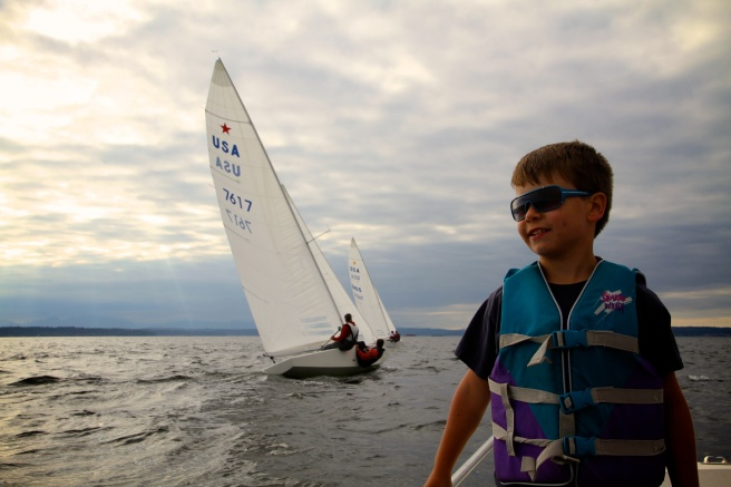 Arden watches as his father, Charley, sails in a regatta. (Charley is the one on the left in the background.)