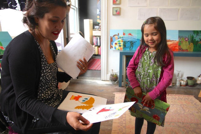 Artist Gina Tolentino looks through Meilee's portfolio and offers comments.